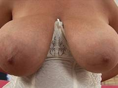 Busty dame masturbating